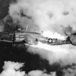 B-24 hit by flak and on fire. Notice fuel bladder bulging from left wing and engine oil spay on the left vertical stabilizer. (USAF archives)